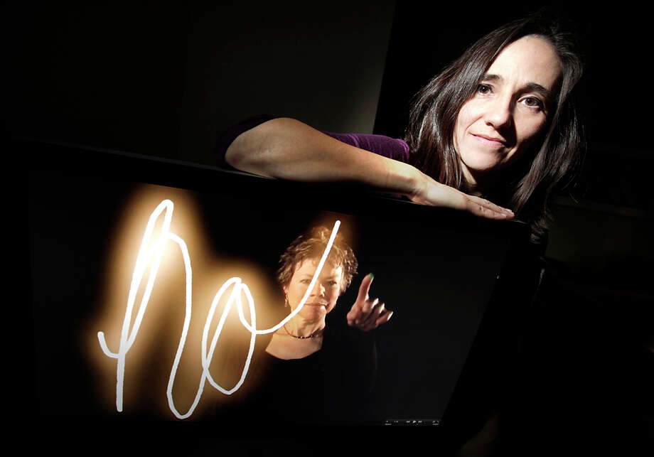 "Guillermina Zabala filmed subjects spelling out a word that represents them — in this case ""hope"" — and added light. Her work will be shown during Luminaria. BOB OWEN / EXPRESS-NEWS"