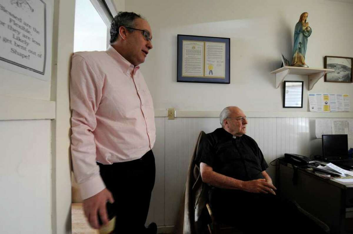Former Congressman John Sweeney(l) spoke to the Times Union March 4, 2011 at the offices of Father Peter Young(r) in Albany, New York. (Skip Dickstein / Times Union)