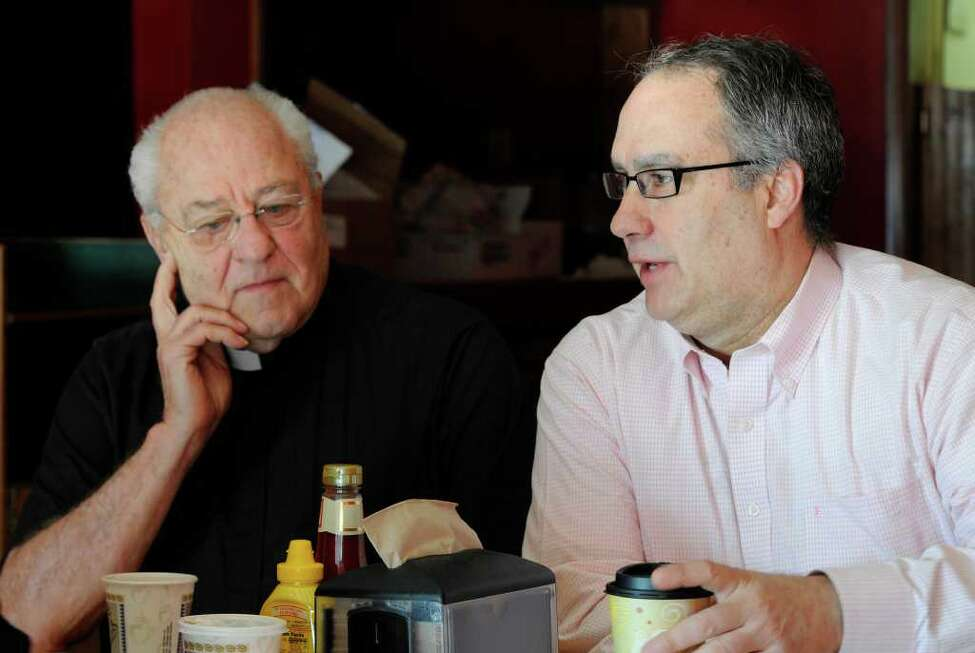 Former Congressman John Sweeney, right, at the offices of the Rev. Peter Young in Albany, New York. (Skip Dickstein / Times Union)