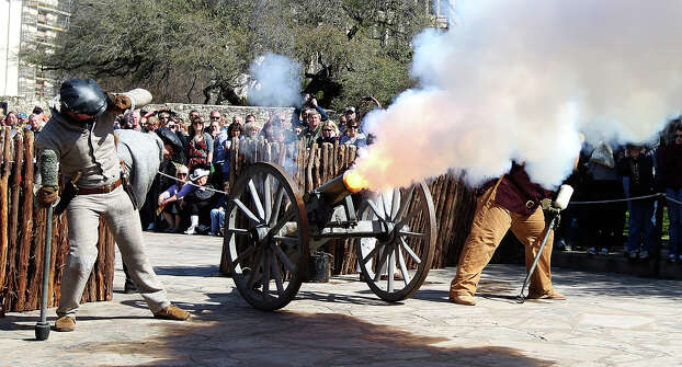 A cannon is fired during a re-enactment of the battle at the Alamo on Saturday, Mar. 5, 2011. Hundred of people lined Alamo Plaza to watch the San Antonio Living History Association perform a re-enactment for the 175th anniversary of the battle at the Alamo. Photo: Kin Man Hui/kmhui@express-news.net / San Antonio Express-News
