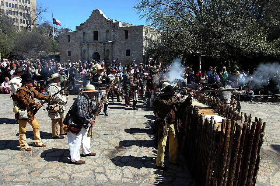 The San Antonio Living History Association perform a re-enactment of the battle at the Alamo for hundred of visitors to the historic site on Saturday, Mar. 5, 2011. This year marked the 175th anniversary of the famous battle. Photo: Kin Man Hui/kmhui@express-news.net / San Antonio Express-News