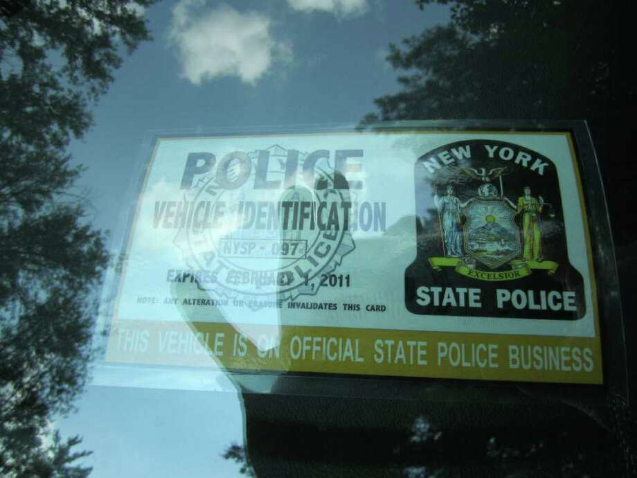 "A State Police ""official business"" placard and emergency lights adorn the dashboard of the private vehicle of Rabbi Bernard Freilich. State Police said they had no part in installing or authorizing Freilich's installation of emergency lights and a siren. Freilich said he uses them only for official business."