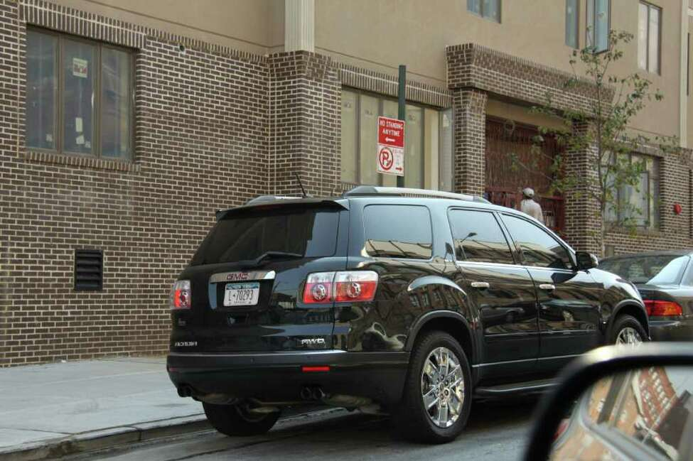 Rabbi Bernard Freilich frequently parks his SUV in restricted parking areas but may avoid summons due to a State Police