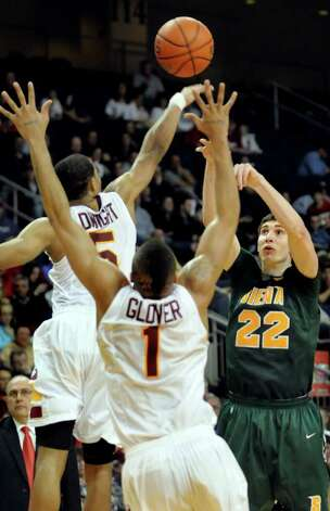 Siena's Ryan Rossiter (22), right, shoots over Iona's Rashon Dwight (5), left, and Mike Glover (1) during their basketball game against Iona at the MAAC Championships on Saturday, March 5, 2011, at Webster Bank Arena at Harbor Yard in Bridgeport, Conn. (Cindy Schultz / Times Union) Photo: Cindy Schultz