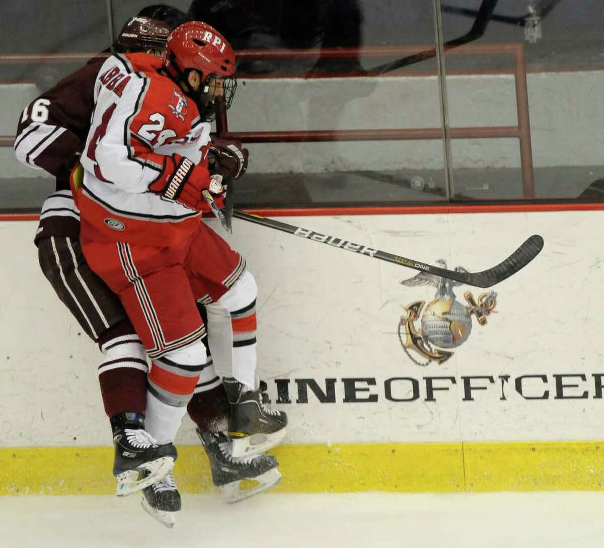Josh Rabbani of RPI ,front, checks Kurtis Bartliff of Colgate into the boards during the first period of Game 2 of their first round playoff series hockey game at Rensselaer Polytechnic Institute in Troy, N.Y., Saturday March5, 2011. (Hans Pennink / Special to the Times Union) College Sports