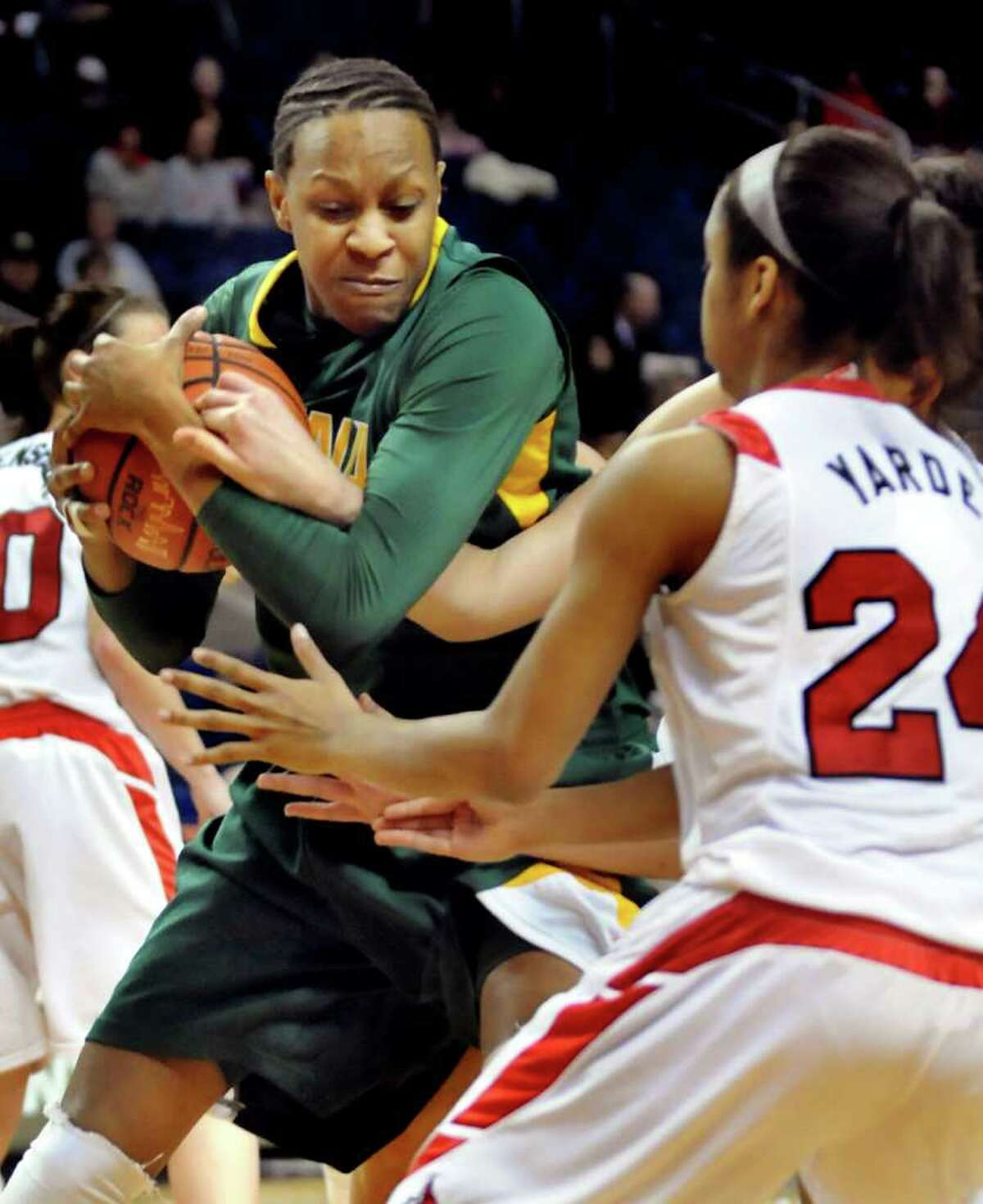 Siena's Serena Moore (32), left, secures the rebound during their basketball game against Marist at the MAAC Championships on Saturday, March 5, 2011, at Webster Band Arena at Harbor Yard in Bridgeport, Conn. (Cindy Schultz / Times Union)