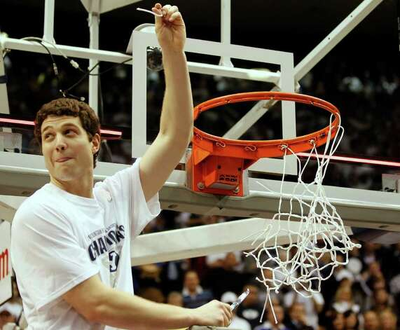 BYU's Jimmer Fredette holds a piece of the net up after a win against Wyoming at an NCAA college basketball game in Provo, Utah, Saturday, March 5, 2011. BYU beat Wyoming 102-78 to win the Mountain West Conference Championship. (AP Photo/George Frey) Photo: George Frey