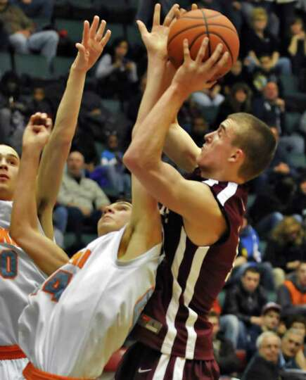 Watervliet's #11 Griffen Kelly , at right, under the net with Catskill's #40 Jeremy Taylor, left,  a