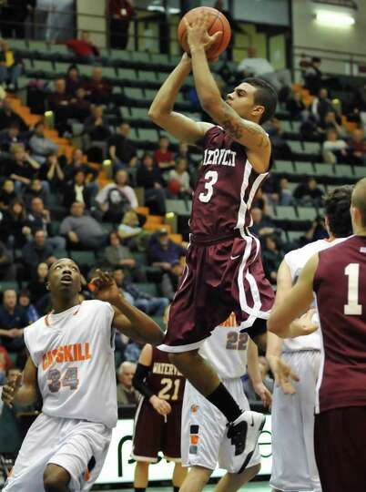 Watervliet's #3 Devonte Gleason gets off a shot against Catskill during the Class BB/B boys' basketb