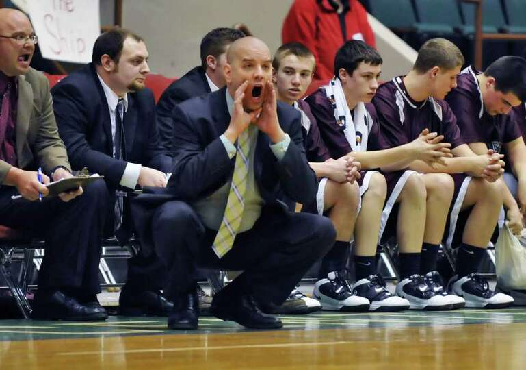Watervliet's head coach Walter Bowden calls instructions to players during the Class BB/B boys' bask