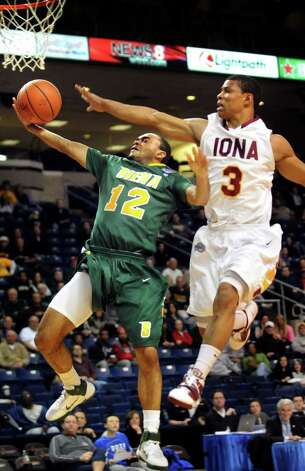 Siena's Rakeem Brookins (12) lay ups two points as Iona's Scott Machado (3) defends during their basketball game at the MAAC Championships on Saturday, March 5, 2011, at Webster Bank Arena at Harbor Yard in Bridgeport, Conn. (Cindy Schultz / Times Union) Photo: Cindy Schultz