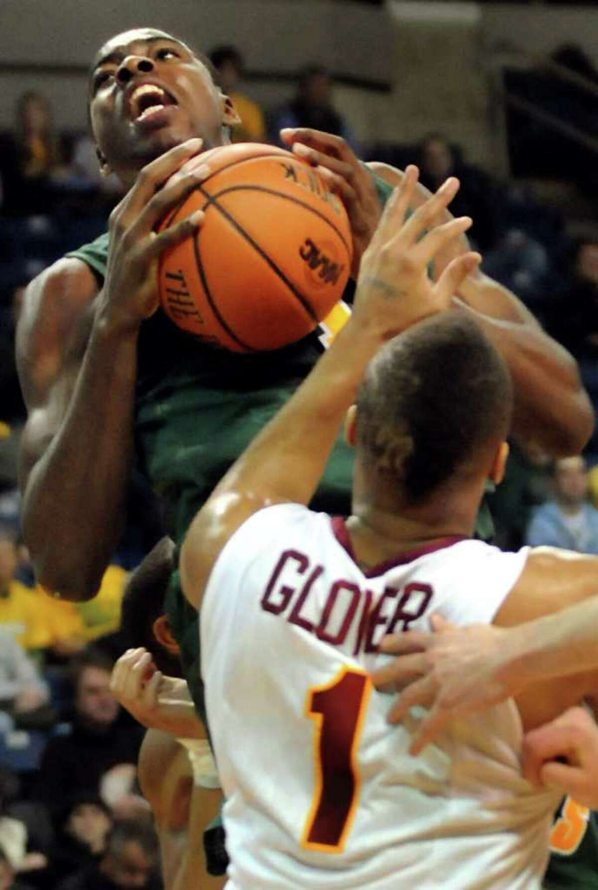 Siena's OD Anosike (1) left, secures a rebound and looks to shoot as Iona's Mike Glover (1) defends during their basketball game at the MAAC Championships on Saturday, March 5, 2011, at Webster Bank Arena at Harbor Yard in Bridgeport, Conn. (Cindy Schultz / Times Union)