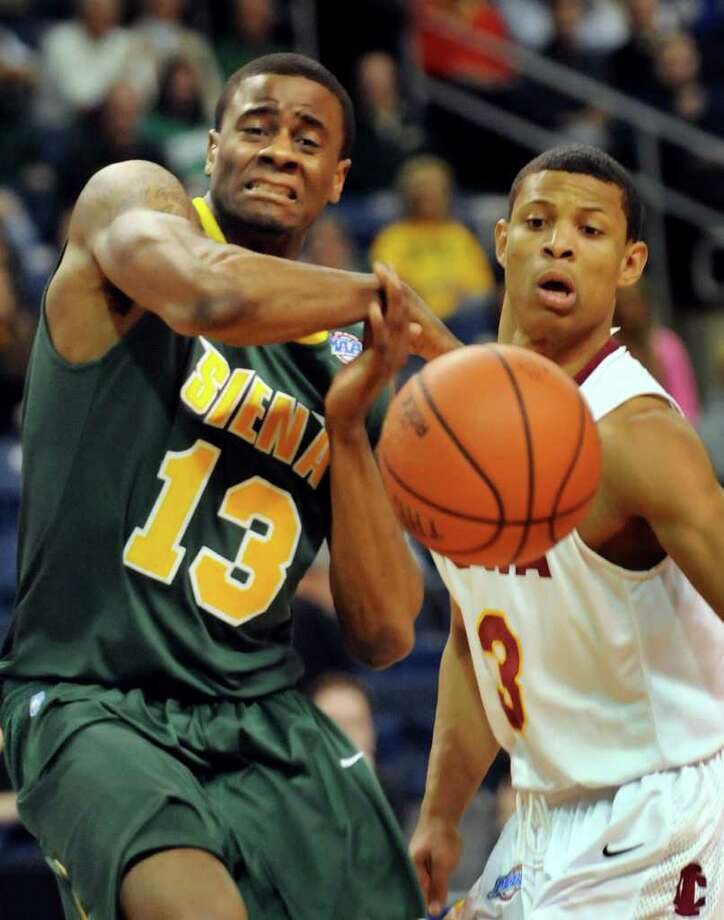 Siena's Clarence Jackson (13) left, passes the ball as Iona's Scott Machado (3) defends during their basketball game at the MAAC Championships on Saturday, March 5, 2011, at Webster Bank Arena at Harbor Yard in Bridgeport, Conn. (Cindy Schultz / Times Union) Photo: Cindy Schultz