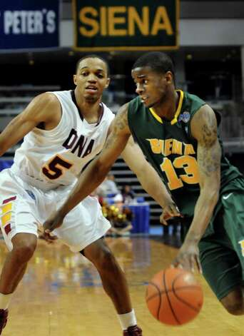 Siena's Clarence Jackso (13), right, drives around Iona's Rashon Dwight (5) during their basketball game at the MAAC Championships on Saturday, March 5, 2011, at Webster Bank Arena at Harbor Yard in Bridgeport, Conn. (Cindy Schultz / Times Union) Photo: Cindy Schultz