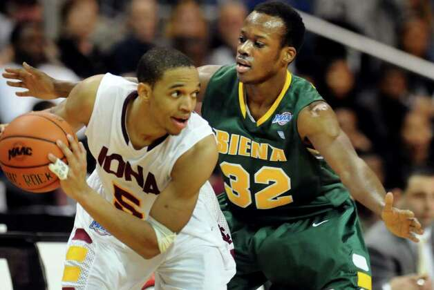 Siena's Kristian Duravcevic (13), right, defends as Iona's Rashon Dwight (5) looks to pass during their basketball game at the MAAC Championships on Saturday, March 5, 2011, at Webster Bank Arena at Harbor Yard in Bridgeport, Conn. (Cindy Schultz / Times Union) Photo: Cindy Schultz