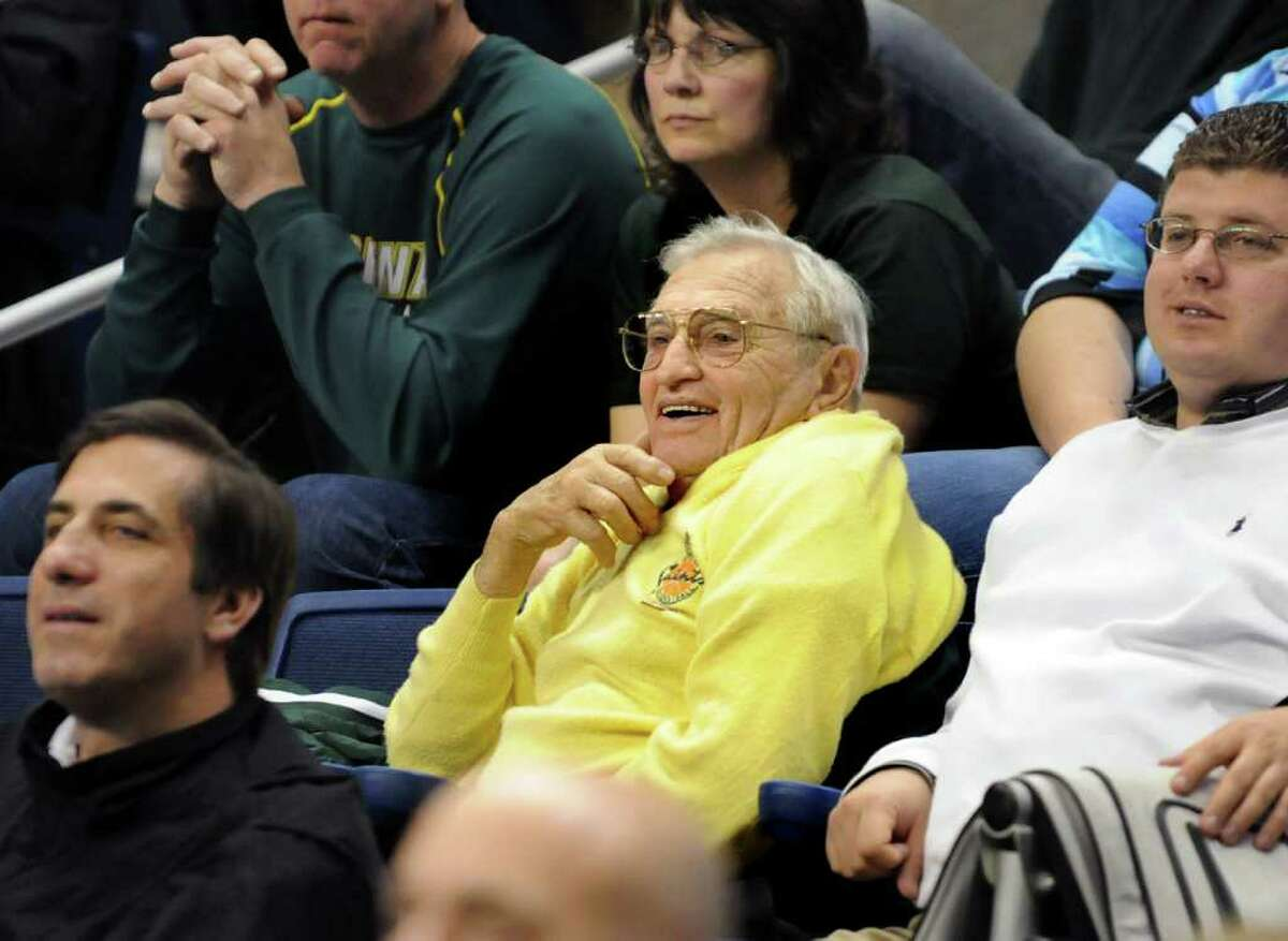 Gino Turchi, longtime Siena basketball fan, center, watches their game against Iona at the MAAC Championships on Saturday, March 5, 2011, at Webster Bank Arena at Harbor Yard in Bridgeport, Conn. (Cindy Schultz / Times Union)