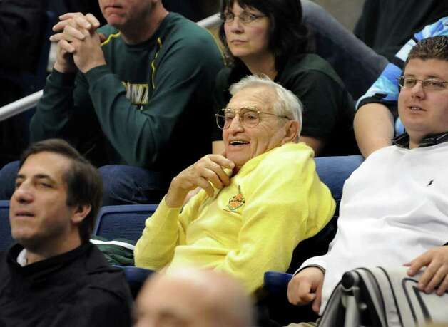 Gino Turchi, longtime Siena basketball fan, center, watches their game against Iona at the MAAC Championships on Saturday, March 5, 2011, at Webster Bank Arena at Harbor Yard in Bridgeport, Conn. (Cindy Schultz / Times Union) Photo: Cindy Schultz