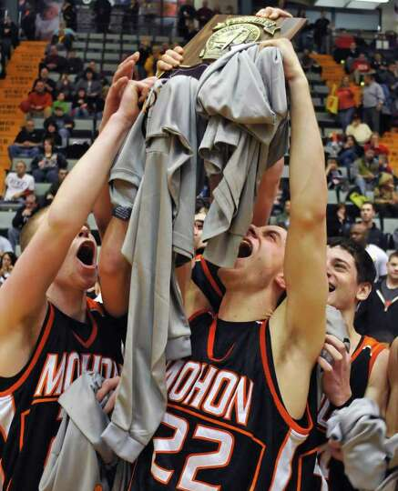 Mohonasen's #22 Ben Dalton, center, and team mates hold their trophy plaque high after beating Scoti
