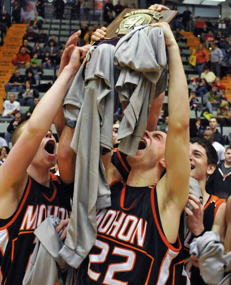 Mohonasen's #22 Ben Dalton, center, and team mates hold their trophy plaque high after beating Scotia to take  the Class A boys' basketball title game at the Glens Falls Civic Center  Saturday Mar. 5, 2011.  (John Carl D'Annibale / Times Union) Photo: John Carl D'Annibale / 00012271A
