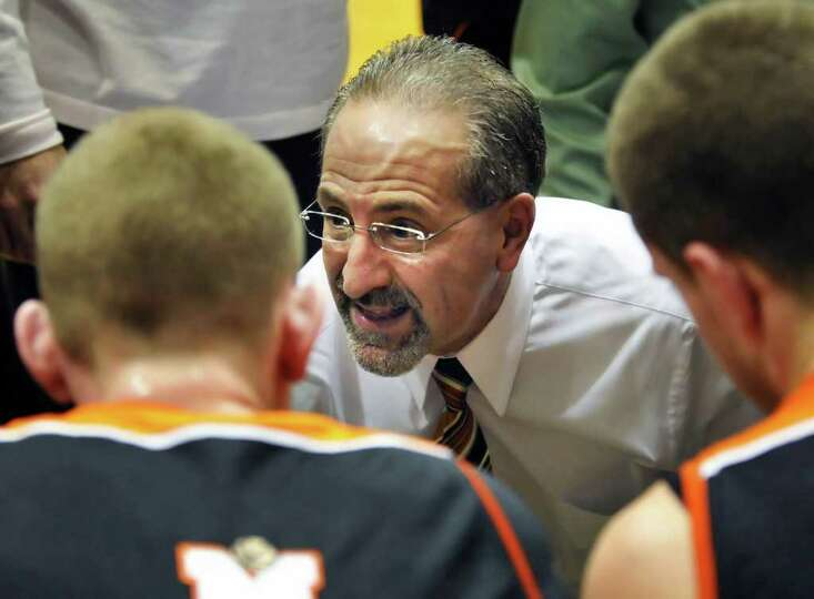 Mohonasen's head coach Ken Dagostino with players during a time out in  the Class A boys' basketball