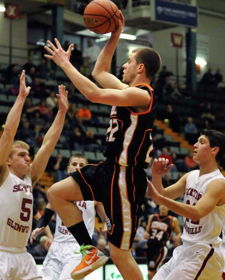 Mohonasen's #22 Ben Dalton, center, takes the ball over the heads of the Scotia defenders during the Class A boys' basketball title game at the Glens Falls Civic Center Saturday Mar. 5, 2011.  (John Carl D'Annibale / Times Union) Photo: John Carl D'Annibale / 00012271A