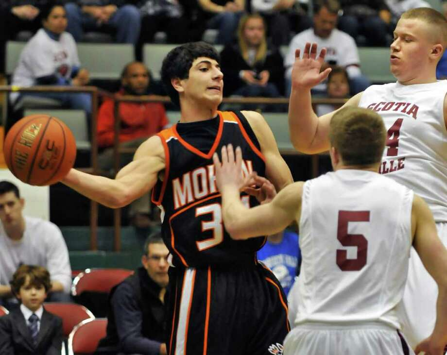 Mohonasen's #34  Billy Manikas, left, gets a pass by Scotia's #5Matt Renko and #34 Tyler Sutherland( at right) during the Class A boys' basketball title game at the Glens Falls Civic Center Saturday Mar. 5, 2011.  (John Carl D'Annibale / Times Union) Photo: John Carl D'Annibale / 00012271A