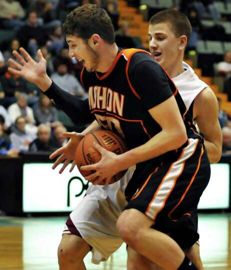 Mohonasen's #50 Garrett Sisson Grant ,left, and Scotia's #23 Terell Winney  during the Class A boys'