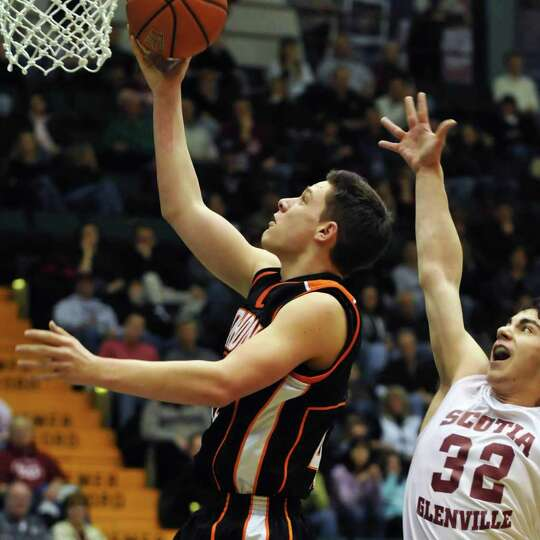 Mohonasen's #42 Grant Massaroni, left, and Scotia's #32 Casey Norton during the Class A boys' basket