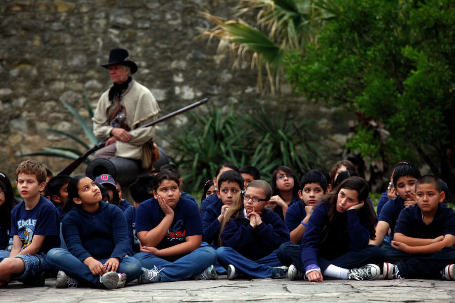 Esparza Elementary School students get a history lesson during a tour of the Alamo. Their school was named for one of the fortress' defenders in 1836. Photo: LISA KRANTZ/lkrantz@express-news.net