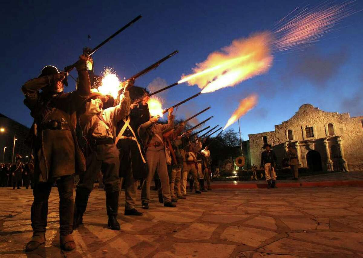 Members of the San Antonio Living History Association fire rifles in front of the Alamo Sunday March 6, 2011 during the