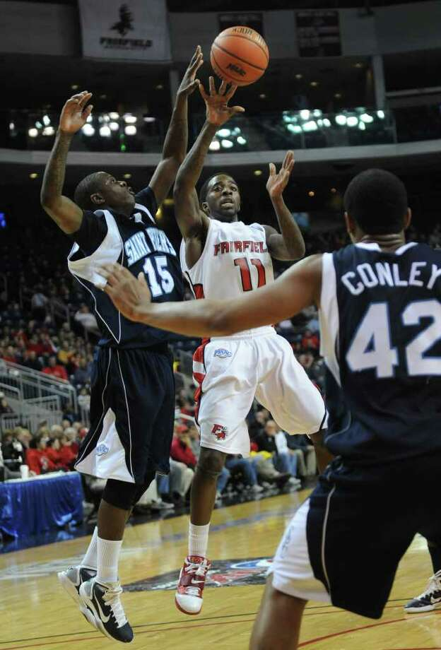 Fairfield's Lyndon Jordan makes a pass while being defended by St. Peter's Wesley Jenkins during the MAAC men's basketball semifinals at the Webster Bank Arena at Harbor Yard in Bridgeport on Sunday, March 6, 2011. Photo: Brian A. Pounds / Connecticut Post