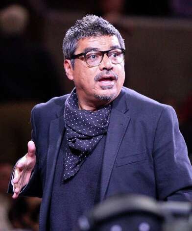 FOR SPORTS - Actor comedian George Lopez does the robot during a timeout at the Spurs Lakers game Sunday March 6, 2011 at the AT&T Center. The Lakers won 99-83.  (PHOTO BY EDWARD A. ORNELAS/eaornelas@express-news.net) Photo: EDWARD A. ORNELAS, SAN ANTONIO EXPRESS-NEWS / SAN ANTONIO EXPRESS-NEWS NFS