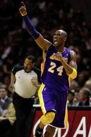 SPURS -- Los Angeles Lakers Kobe Bryant celebrates during the second half at the AT&T Center, Sunday, March 6, 2011. Bryant led the Lakers with 26 points in their victory over the San Antonio Spurs, 99-83. JERRY LARA/glara@express-news.net Photo: JERRY LARA, San Antonio Express-News / SAN ANTONIO EXPRESS-NEWS (NFS)