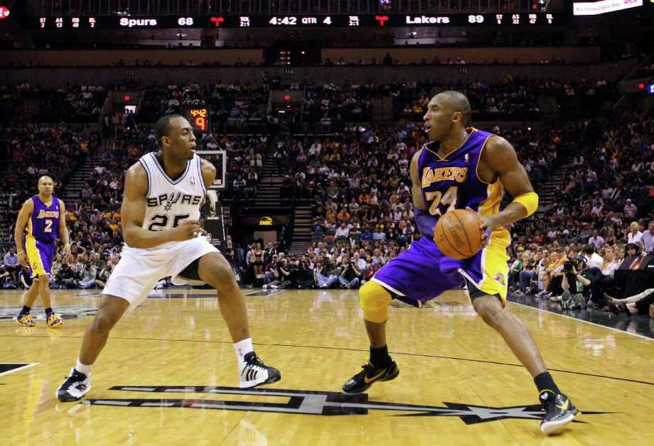 FOR SPORTS - Lakers' Kobe Bryant looks for room around Spurs' James Anderson during second half action Sunday March 6, 2011 at the AT&T Center. The Lakers won 99-83.  (PHOTO BY EDWARD A. ORNELAS/eaornelas@express-news.net) Photo: EDWARD A. ORNELAS, SAN ANTONIO EXPRESS-NEWS / SAN ANTONIO EXPRESS-NEWS NFS