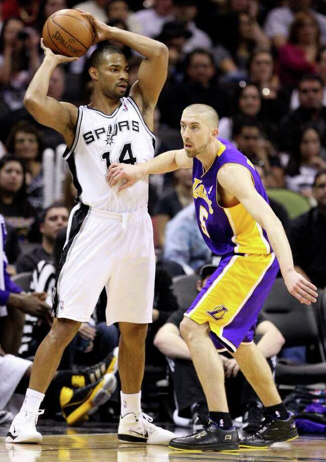 FOR SPORTS - Spurs' Gary Neal looks to pass around  Lakers' Steve Blake during second half action Sunday March 6, 2011 at the AT&T Center. The Lakers won 99-83.  (PHOTO BY EDWARD A. ORNELAS/eaornelas@express-news.net) Photo: EDWARD A. ORNELAS, SAN ANTONIO EXPRESS-NEWS / SAN ANTONIO EXPRESS-NEWS NFS