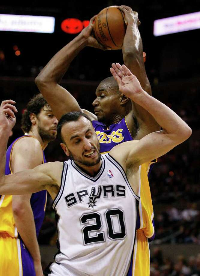 SPURS -- Los Angeles Lakers Andrew Bynum keeps the ball away from San Antonio Spurs Manu Ginobili during a second half rebound at the AT&T Center, Sunday, March 6, 2011. The Lakers won 99-83. JERRY LARA/glara@express-news.net Photo: JERRY LARA, San Antonio Express-News / SAN ANTONIO EXPRESS-NEWS (NFS)
