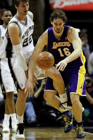 SPURS -- San Antonio Spurs Tiago Splitter trips Los Angeles Lakers Pau Gasol as he tries to keep him from the basketball during the second half at the AT&T Center, Sunday, March 6, 2011. The Lakers won 99-83. JERRY LARA/glara@express-news.net Photo: JERRY LARA, San Antonio Express-News / SAN ANTONIO EXPRESS-NEWS (NFS)
