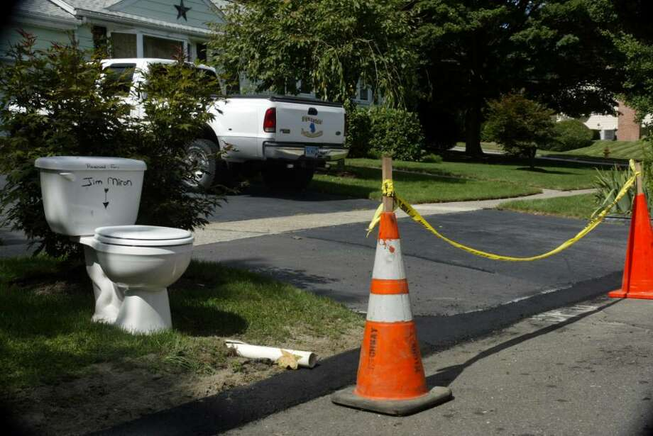 The Town of Stratford repaired snowplow damage to Grant Dalling's driveway on Bunnyview Drive, monday, Sept. 14.The toilet still remains in the driveway a silent protest to the Mayor and other Stratford officials. Photo: Phil Noel / Connecticut Post