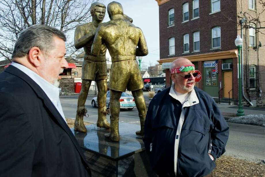 "Ralph Antonacci and Anthony Pellicci with the sculpture of Muhammad Ali and Joe Frazier in ""Boxer's Square"" on Stillwater Avenue in Stamford, Conn., Sunday, February 27, 2011. Photo: Keelin Daly / Stamford Advocate"