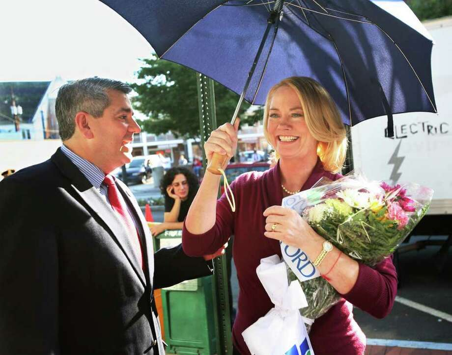 "Actress Cybill Shepherd receives flowers from then mayor of Stratford, James Miron during a break in filming of the movie, ""Listen to Your Heart"", at the site of the former Ciao Restaurant on Main Street in downtown Stratford, Conn. in 2008. Photo: Brian A. Pounds / Connecticut Post"