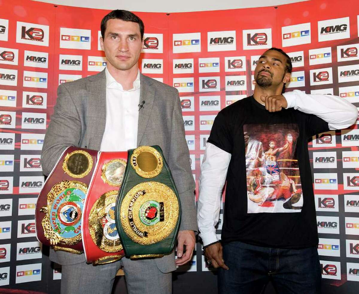 FILE - In this Thursday, April 16, 2009 file photo, World heavyweight boxing champion Wladimir Klitschko, with his belts, and British challenger David Haye are pictured at a press conference at the Veltins-Arena in Gelsenkirchen, Germany. IBF and WBO champion Wladimir Klitschko and British challenger David Haye finally have agreed to fight, setting up an eagerly anticipated heavyweight title bout for this summer. Both boxers confirmed Sunday the fight should take place on June 25 or July 2 in Germany. (AP Photo/Martin Meissner, File)