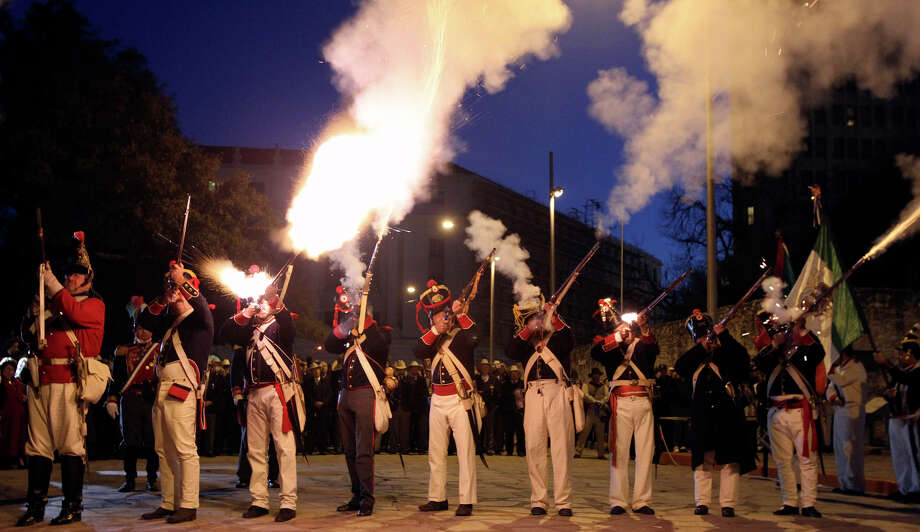 "Members of the San Antonio Living History Association representing the Mexican army fire rifles in front of the Alamo Sunday March 6, 2011 during the ""Dawn at the Alamo"" ceremony that honors the fallen of the 1836 Battle of the Alamo. The ceremony was held in honor of the 175th anniversary of the famous battle between Texian defenders and Mexican troops. Photo: JOHN DAVENPORT/jdavenport@express-news.net / SAN ANTONIO EXPRESS-NEWS (Photo may be sold to the public)"