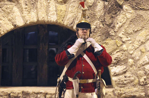 Ron Strybos gets suited up by the long barracks at the Alamo for the Dawn at the Alamo ceremony conducted by the San Antonio Living History Association Sunday March 6, 2011. The event was held to commemorate thw 175th anniversary of the Battle of the Alamo. Photo: JOHN DAVENPORT/jdavenport@express-news.net