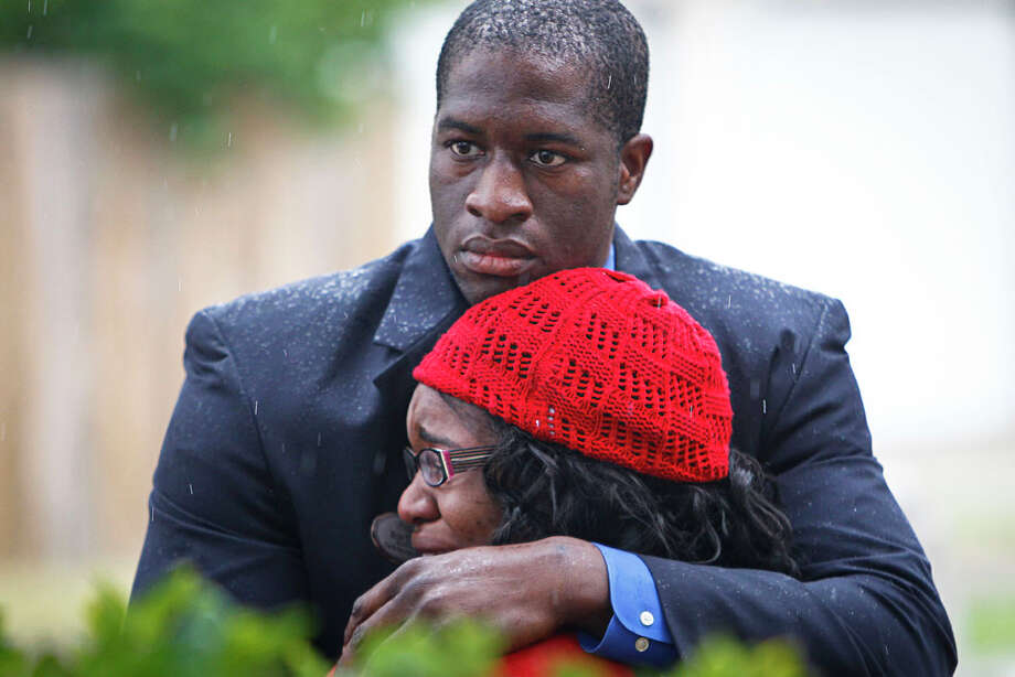 Ron Tata hugs his sister Jessica Tata, operator of a Houston home day care, shortly after a fire there killed four children on Feb. 24. Photo: Michael Paulsen/Houston Chronicle