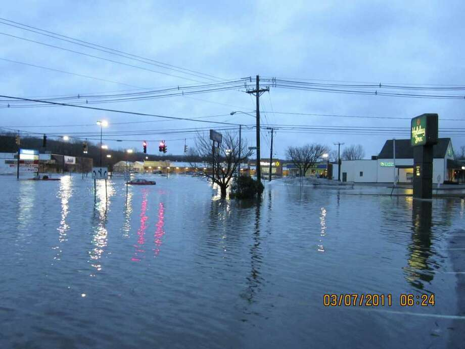These shots show the flooding at the entrance to Commerce Park off of Newtown Road in Danbury. Photo: Contributed  / News Times