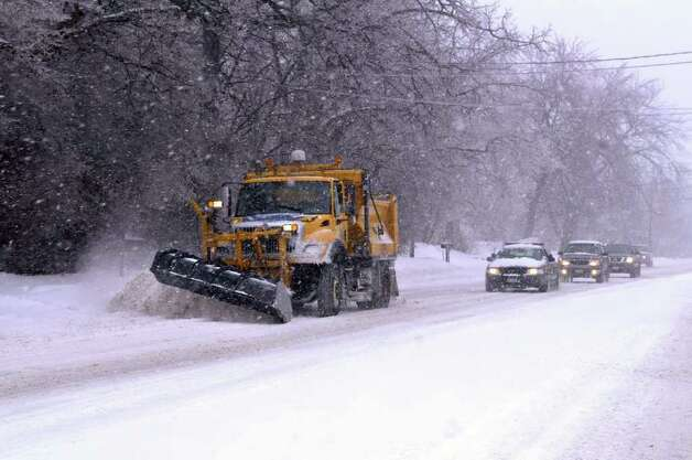 A snowplow clears Albany Shaker Road in Colonie, NY, on Monday, March 7, 2011, as another winter storm hit the Capital Region.  (Paul Buckowski / Times Union) Photo: Paul Buckowski / 00012307A