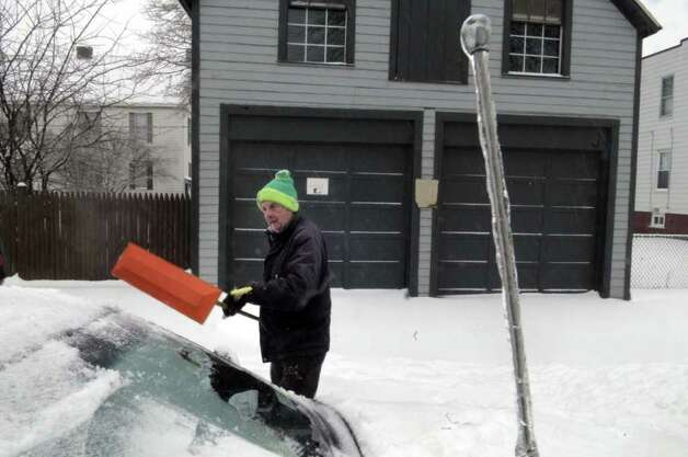 Ice covers the car antenna as Henry Vanderwerken of Watervliet, NY, clears his car of ice on Monday, March 7, 2011, as another winter storm hit the Capital Region.  (Paul Buckowski / Times Union) Photo: Paul Buckowski / 00012307A