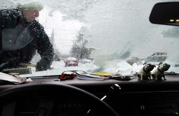 Henry Vanderwerken, of Watervliet, NY, clears his car of ice on Monday, Mar. 7, 2011, as another winter storm hit the Capital Region.  (Paul Buckowski / Times Union) Photo: Paul Buckowski  / 00012307A