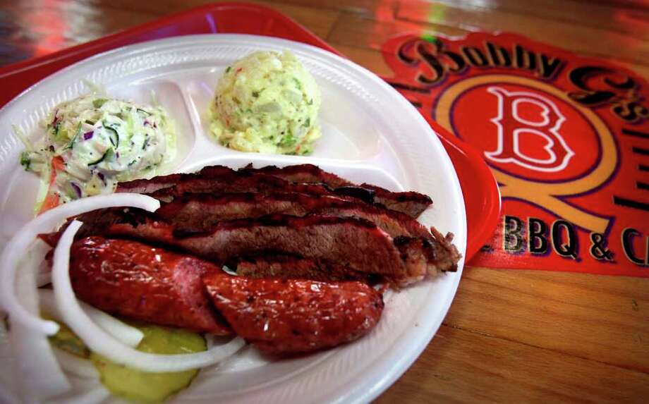 Bobby G's Old School BBQ & Catering,2203 Nogalitos. A meat plate with sausage, brisket, and two salads. Photo: Bob Owen, San Antonio Express-News / rowen@express-news.net