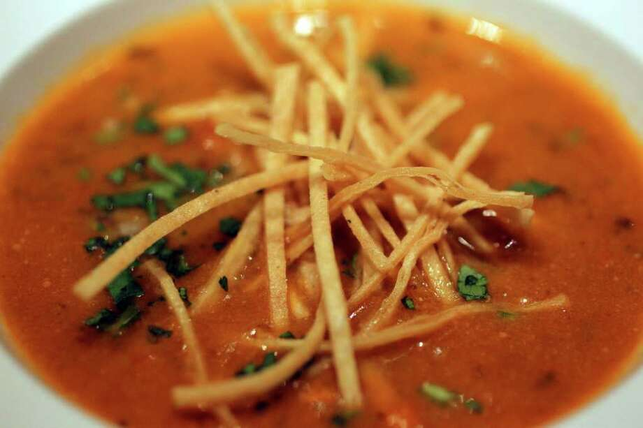 Although no longer on the menu at the Achiote River Cafe & Bar, the Grand Hyatt Hotel still offers tortilla soup via room service. Photo: JOHN DAVENPORT, SAN ANTONIO EXPRESS-NEWS / SAN ANTONIO EXPRESS-NEWS (Photo can be sold to the public)